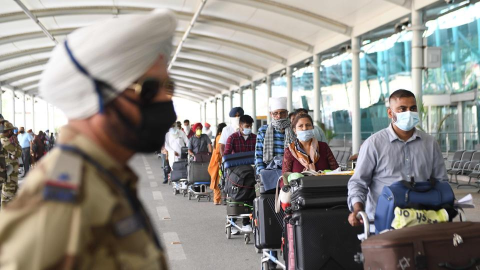 A policeman keeps watch at Sri Guru Ram Dass Jee International Airport in Amritsar on May 19, 2020.
