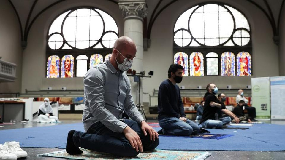 Muslims pray inside the evangelical church of St. Martha's parish, during their Friday prayers, as the community mosque can't fit everybody in due to social distancing rules, amid the Covid-19 outbreak in Berlin, Germany, May 22, 2020.