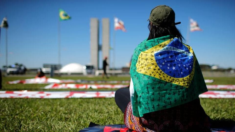 A demonstrator takes part in a protest against Brazil's President Jair Bolsonaro in front of the National Congress, amid the coronavirus disease outbreak, in Brasilia, Brazil.