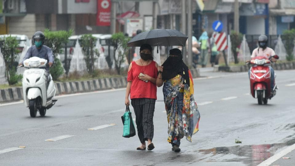 Women walking under an umbrella during rain brought about by the approach of Cyclone Amphan, in Ranchi, Jharkhand.