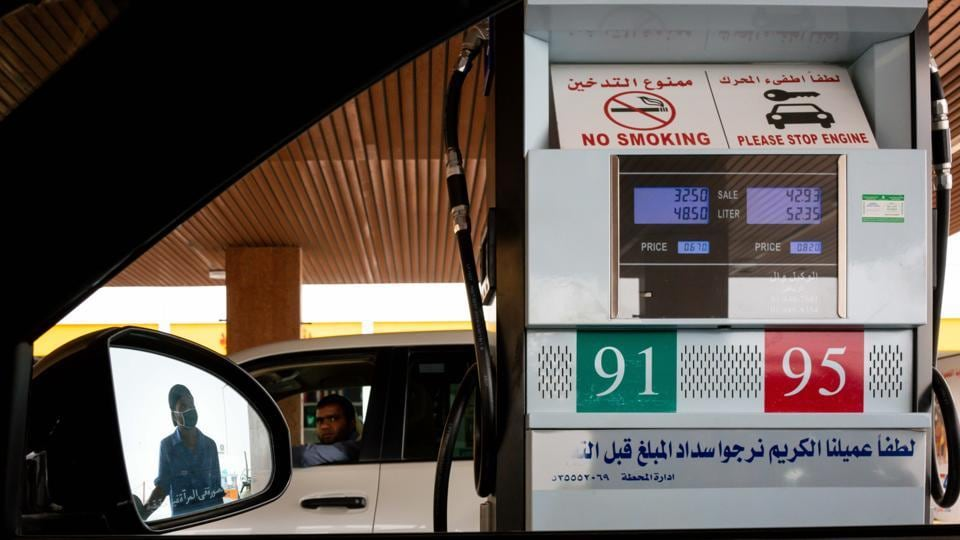 An attendant fills an automobile with fuel at a gas station in Riyadh, Saudi Arabia, on Tuesday, May 19, 2020.