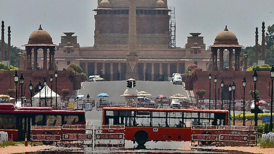 A mirage forms along Rajpath as the temperature soars on a hot day in New Delhi on Saturday. The severe heat is expected to worsen over the next few days.