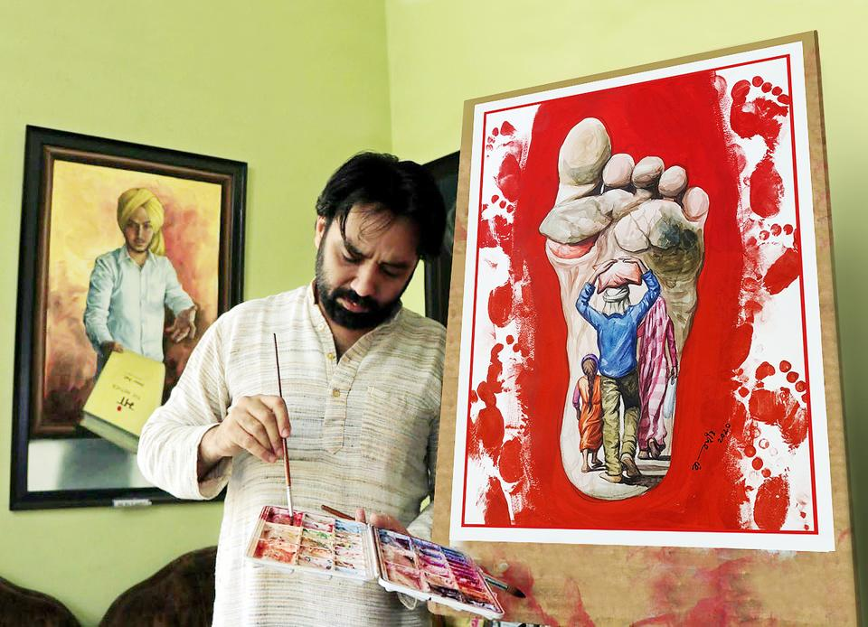 Gurpreet Bathinda with his artwork.