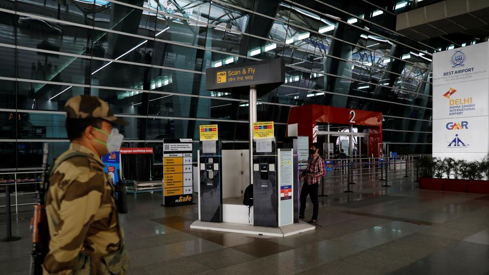 A man checks the Scan & Fly kiosks, after the government allowed domestic flight services to resume from coming Monday, during an extended nationwide lockdown to slow the spread of the coronavirus disease, at the Indira Gandhi International (IGI) Airport, in New Delhi on Saturday.