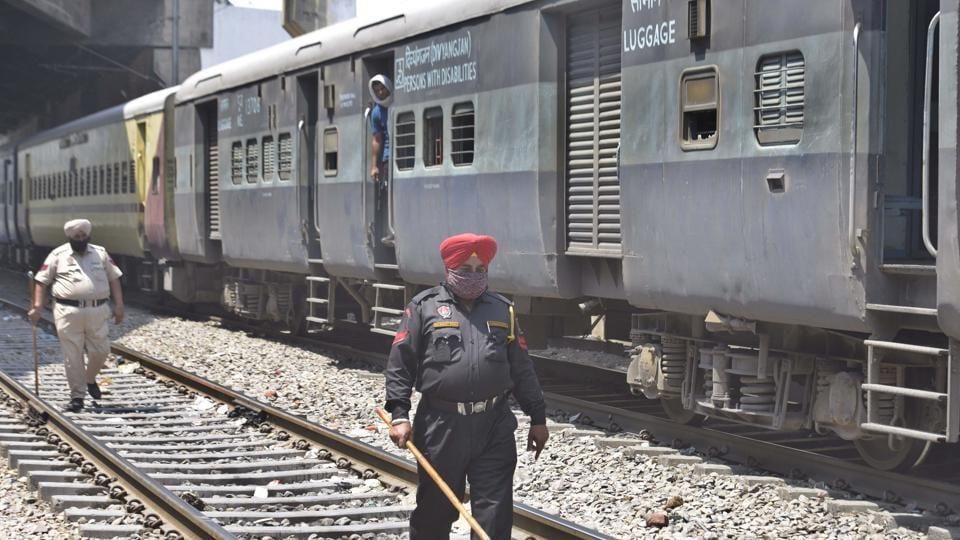 Police deployed on railway tracks near Jagroan bridge area to prevent illegal boarding on Shramik Special trains in Ludhiana on Saturday.