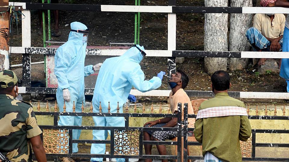 Assam, May 16 (ANI): Medics collect swab samples of migrant workers for the COVID-19 test after a worker working in a potato godown at the fancy bazaar tested positive for coronavirus during the ongoing COVID-19 nationwide lockdown, in Guwahati on Saturday. (ANI Photo)