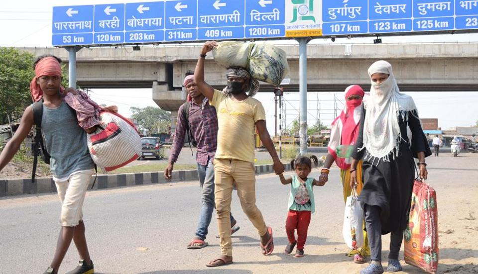 Family members of migrant labourer on foot proceeding from Delhi to their native place , during the nationwide COVID-19 lockdown, in Dhanbad, Tuesday on  May 19, 2020.