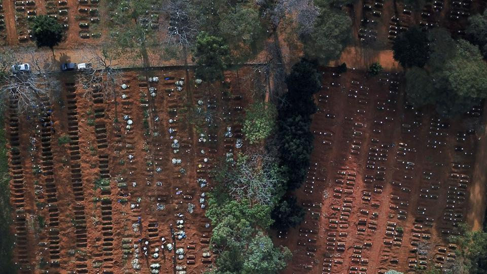 Open and occupied graves are seen during the outbreak of the coronavirus disease, at Vila Formosa cemetery, Brazil's biggest, in Sao Paulo on May 22.