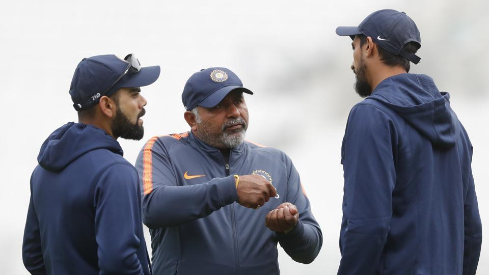 India's Virat Kohli, left, speaks with Bharat Arun the Indian bowling coach, center, and Ishant Sharma during a nets session