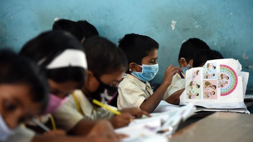 Students of a School in Kopar Khairane wear mask to school as a preventive measure from coronavirus in Navi Mumbai.