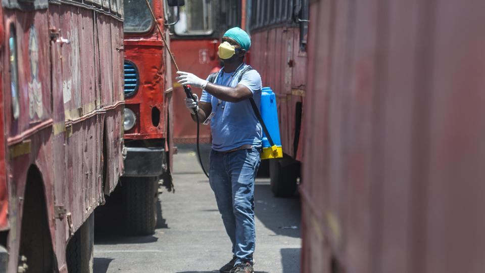 Ashok Kurmi member of Sion Friends circle sanitise the ST buses which used for transporting migrant workers to LTT, Bandra and CST station at Sion in Mumbai on Sunday.