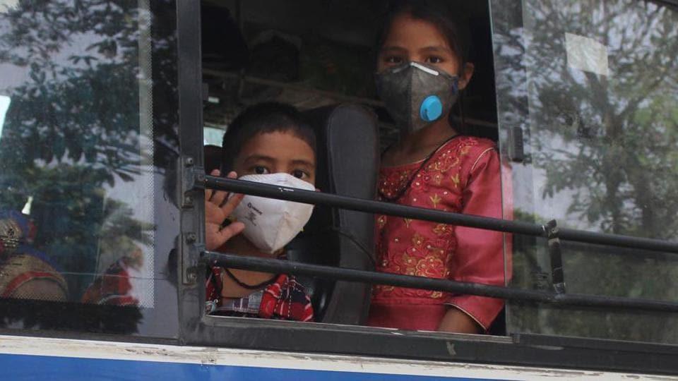 Migrants on board buses bound for Uttarakhand, during lockdown.