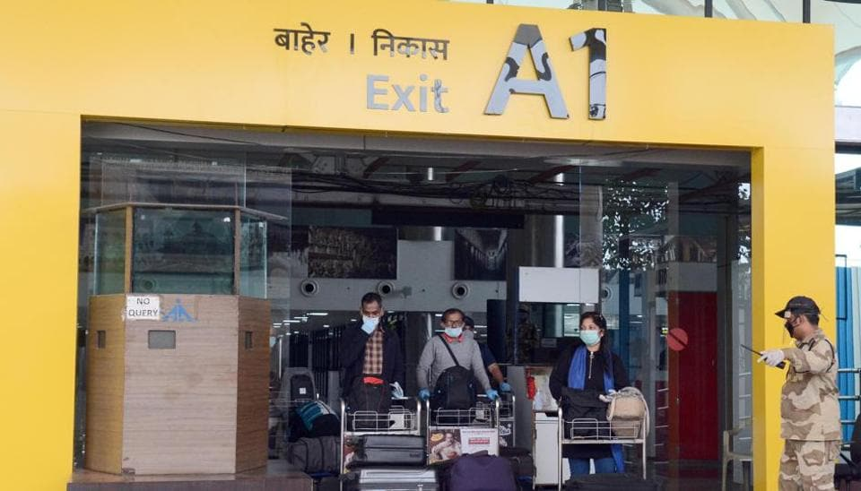 Passengers arrive at Pune International airport, amid the concerns over the spread of Covid-19.