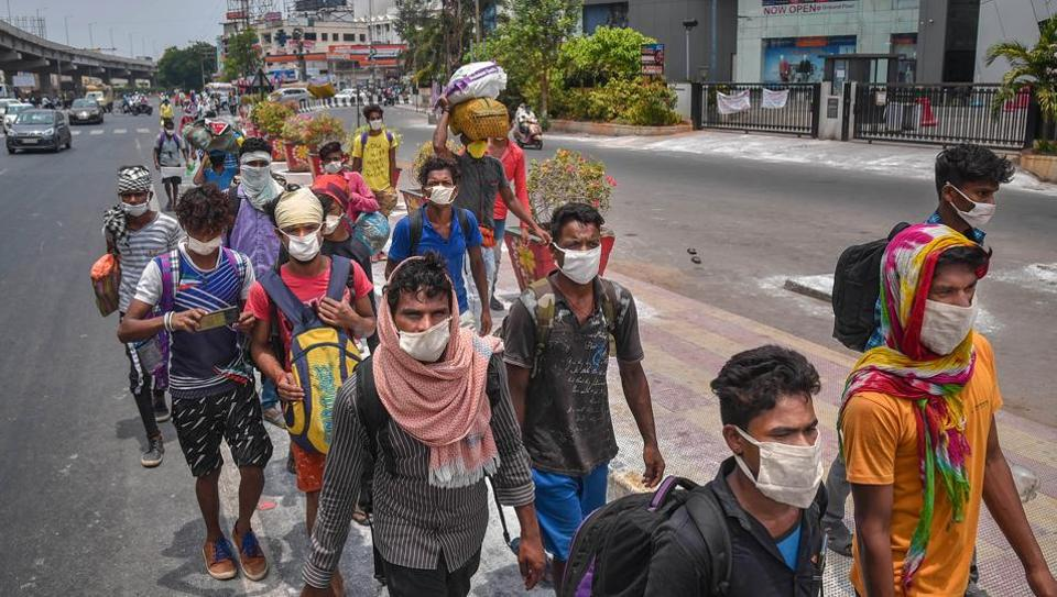 Migrants walk along the Chennai-Kolkata highway toreach to their native places in Chhattisgarh and Jharkhand,during the ongoing COVID-19 nationwide lockdown, in Vijayawada, Tuesday, May 19, 2020/ representative.