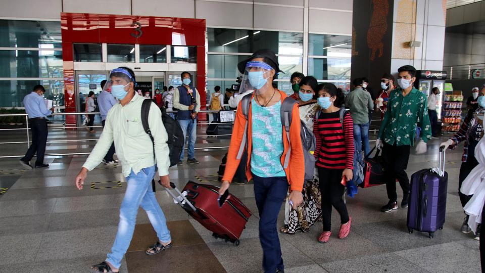 Passengers arrive at Delhi's Indira Gandhi International airport on the first day of the resumption of domestic on Monday.