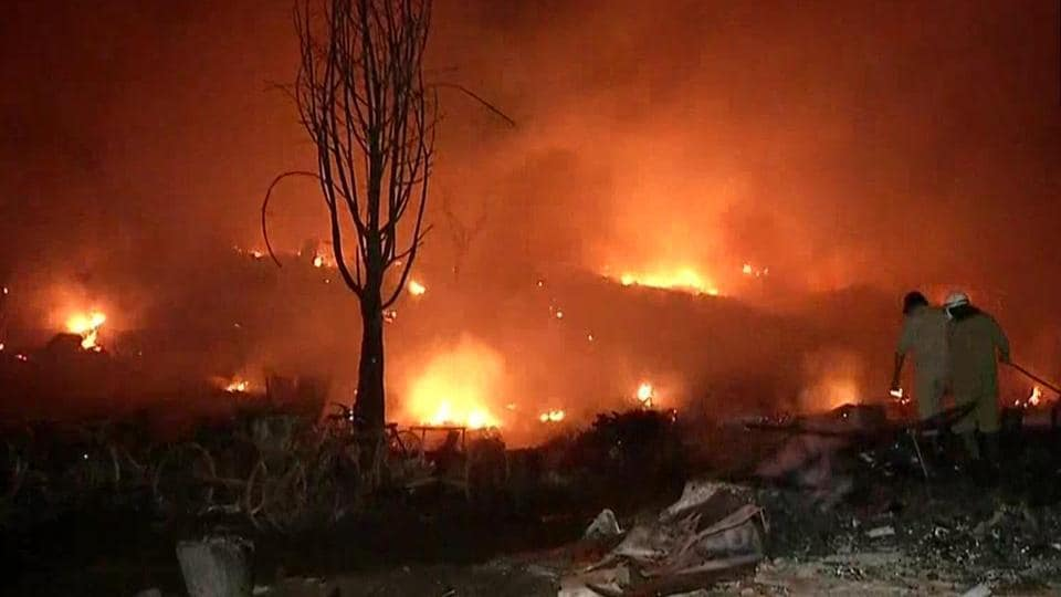 Firefighters trying to control the blaze in Tughlakabad on Tuesday.