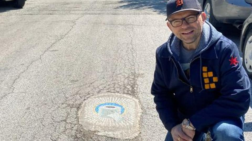 Chicago artist Jim Bachor creates four pandemic-themed pothole mosaics on the city's North Side, during the coronavirus disease (COVID-19) outbreak in Chicago, Illinois, U.S., May 20, 2020. Picture taken May 20, 2020. REUTERS/Brendan O'Brien