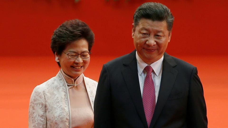 Hong Kong Chief Executive Carrie Lam and Chinese President Xi Jinping walk after Lam took her oath, during the 20th anniversary of the city's handover from British to Chinese rule, in Hong Kong.