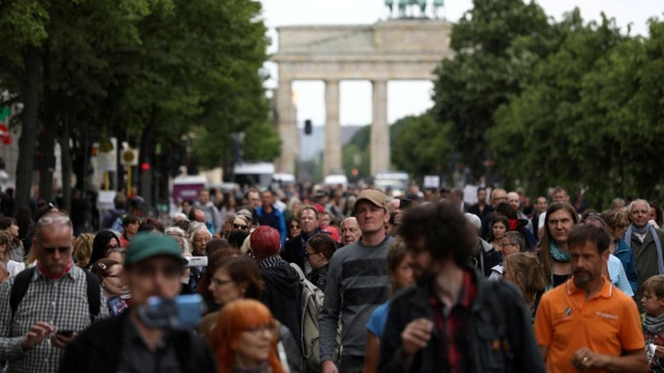 People attend a protest against the government's restrictions following the coronavirus disease (COVID-19) outbreak, in Berlin, Germany.