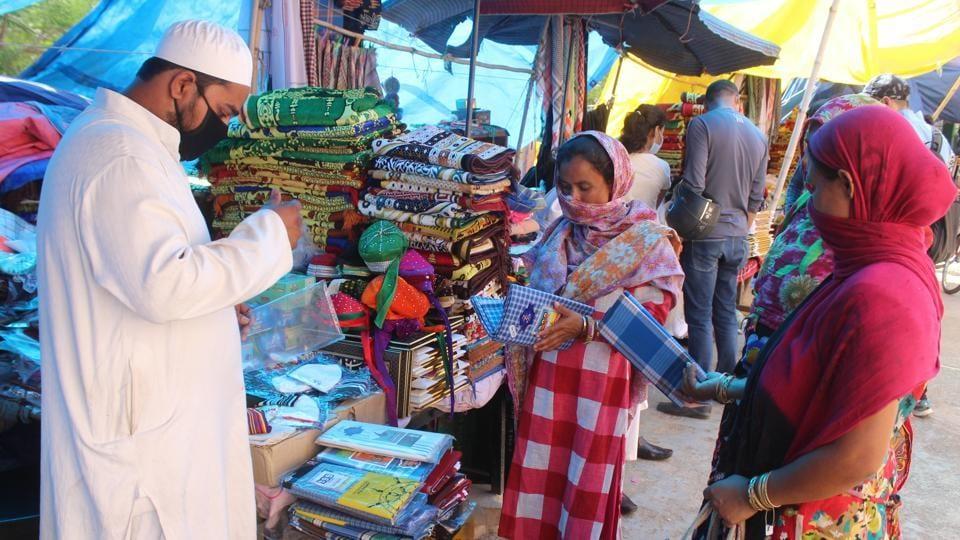 People seen at Jama Masjid market ahead of Eid ul-Fitr, in Sadar Bazar.