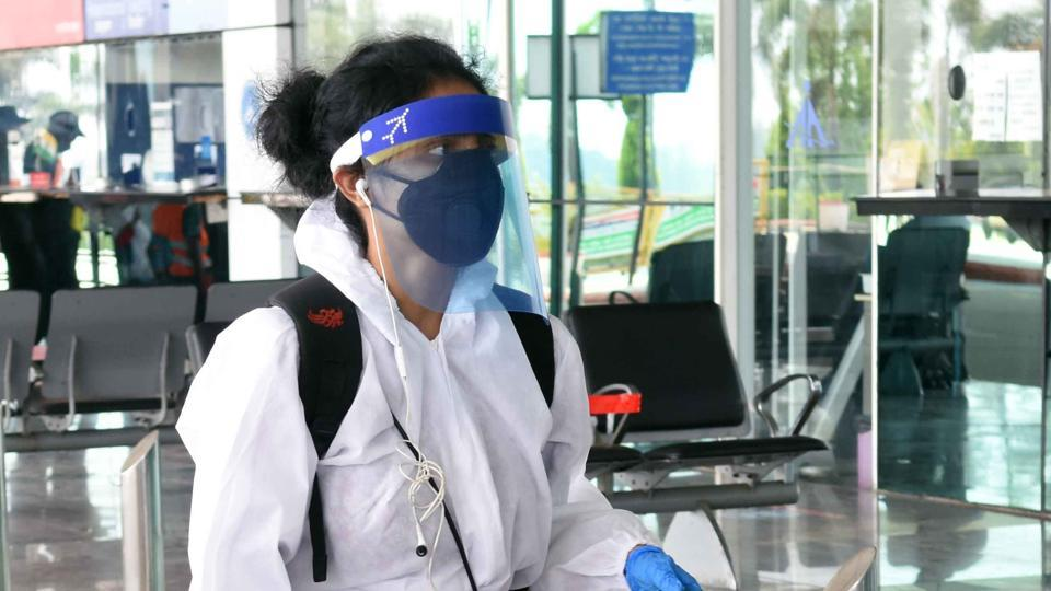 An air passenger in PPE kit due to spread of Coronavirus in New Delhi.