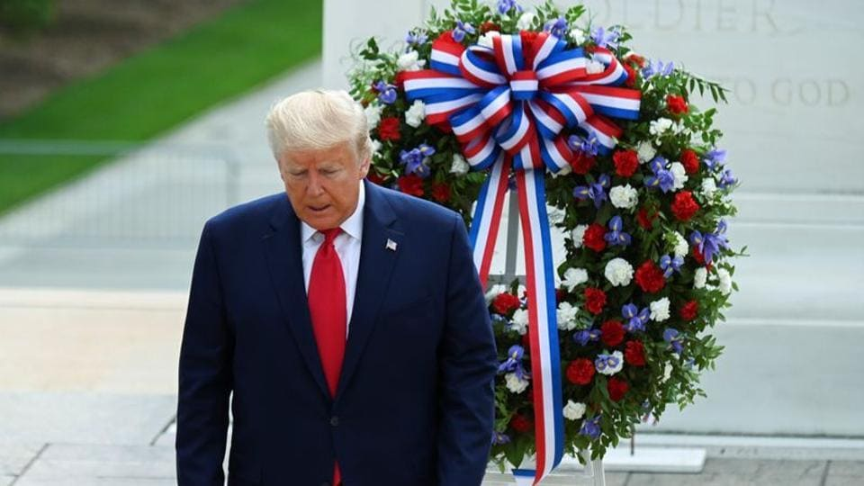 U.S. President Donald Trump participates in a wreath laying ceremony at the Tomb of the Unknown Soldier at Arlington National Cemetery near Washington in commemoration of the Memorial Day holiday in Arlington, Virginia, U.S., May 25, 2020. REUTERS/Erin Scott