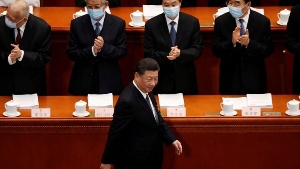 Chinese President Xi Jinping walks past officials wearing face masks following the coronavirus disease (COVID-19) outbreak as he arrives for the opening session of the National People's Congress (NPC) at the Great Hall of the People in Beijing, China.