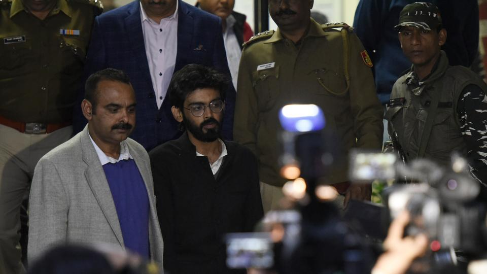 JNU student Sharjeel Imam is seen with Crime branch officials after he was arrested from Bihar, at Saket Police station, in New Delhi, on January 29, 2020.