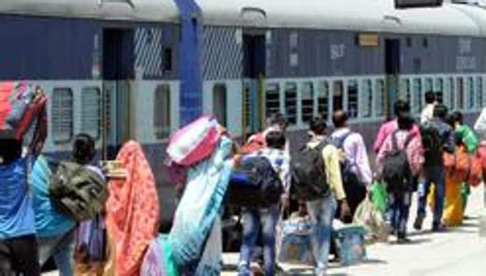 Migrants arrive at board a Shramik Special train to Uttar Pradesh from  Patiala in  Punjab.
