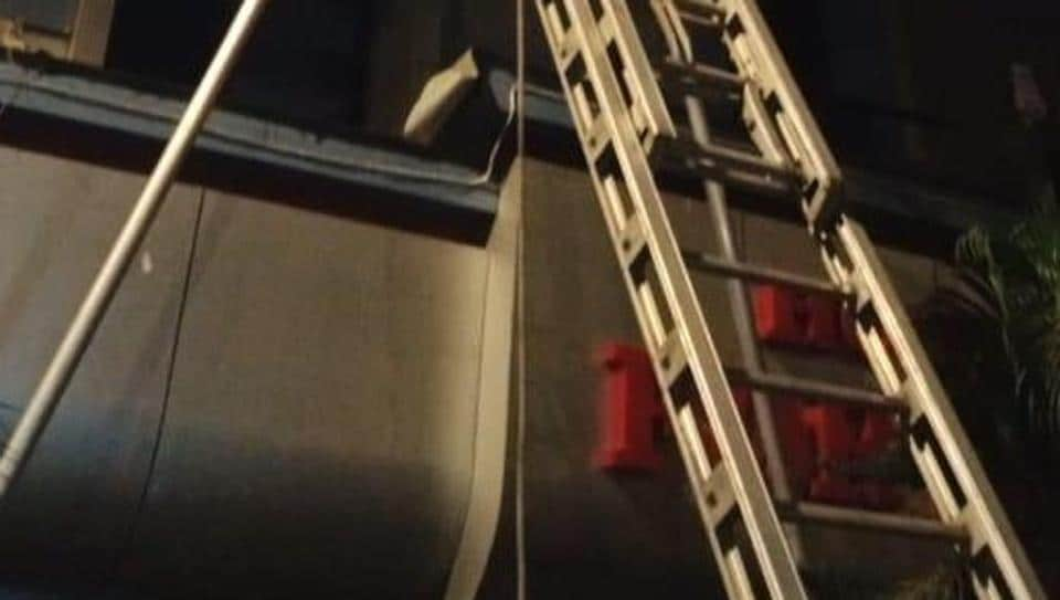 The fire brigade used a ladder to rescue five people from the burning hotel building at Dhobi Talao on Wednesday.
