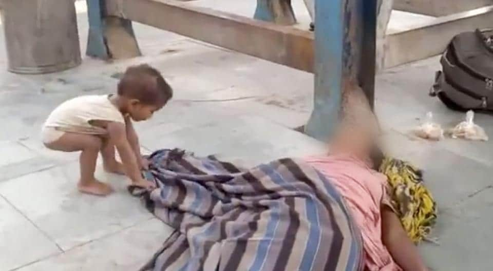 A toddler tries to wake his dead mother at Muzaffarpur railway station in Bihar.