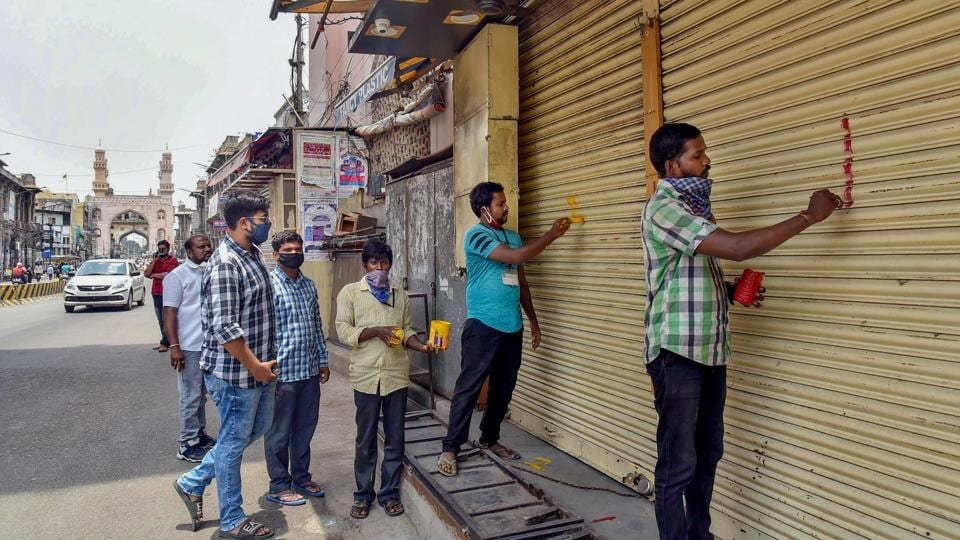 Hyderabad: GHMC officials put marks on shops after Telangana government permitted shopkeepers to open their establishments on odd-even basis, during the ongoing COVID-19 lockdown, at Charminar in Hyderabad, Tuesday, May 19, 2020. (PTI Photo) (PTI19-05-2020_000192A)