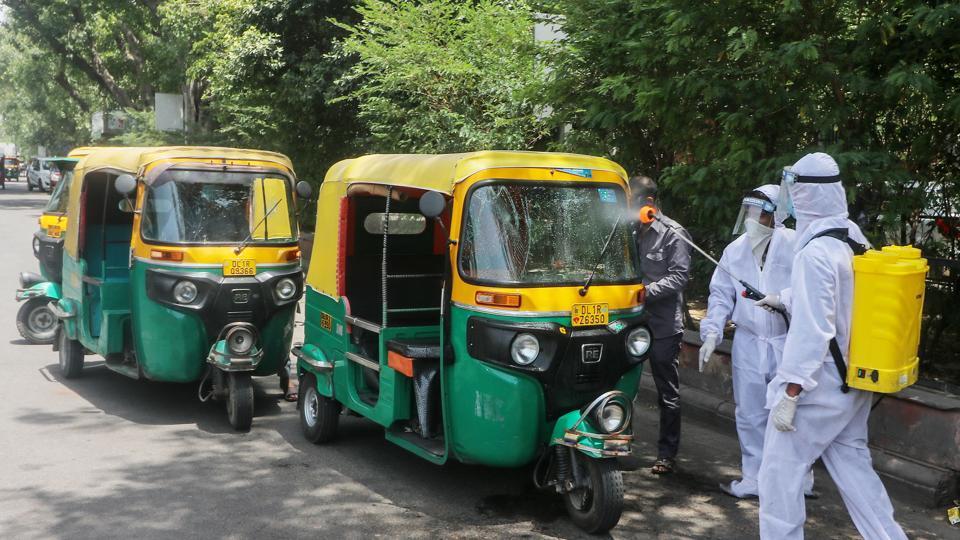 Sanitisation of autorickshaws being done inNew Delhi onWednesday to check the spread of coronavirus disease Covid-19.