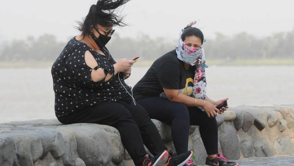 Residents enjoying the breeze at Sukhna Lake in Chandigarh on Thursday.