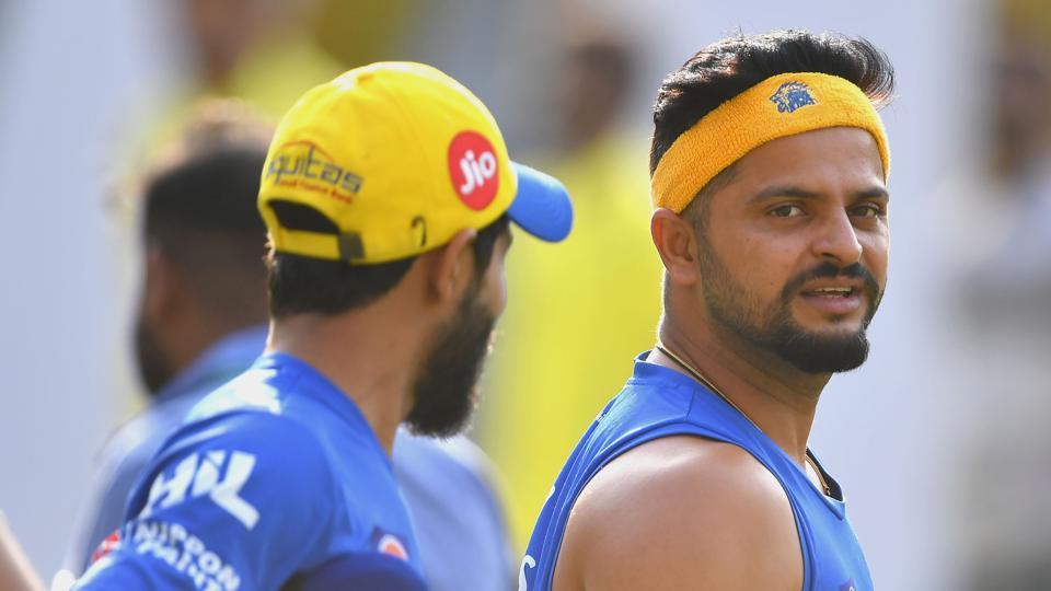 Chennai Super Kings cricketer Ravindra Jadeja (L) and Suresh Raina