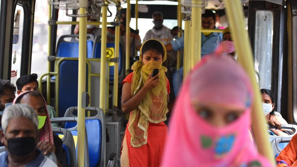 A view inside a DTC bus with people seated while observing social distancing in New Delhi on Thursday.