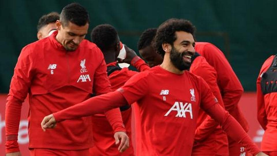 Liverpool's Croatian defender Dejan Lovren (L) and Liverpool's Egyptian midfielder Mohamed Salah attend a team training session at Melwood in Liverpool (File photo)