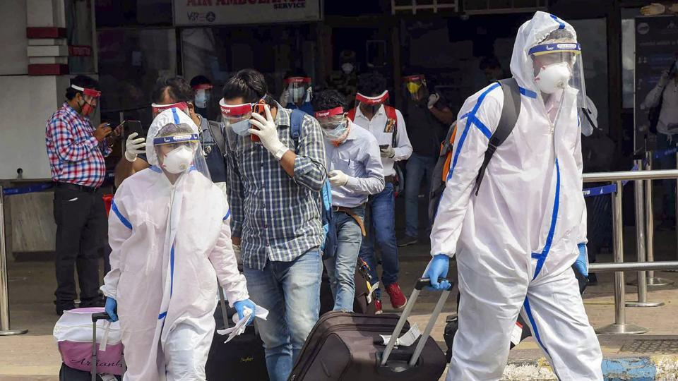 Passengers wearing PPE kits check-out from the Jai Prakash Narayan International Airport upon their arrival from Bengaluru in Patna.
