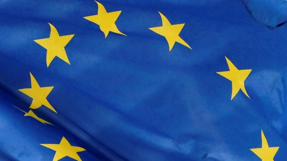 A European flag is seen outside the EU Commission headquarters in Brussels, Belgium.