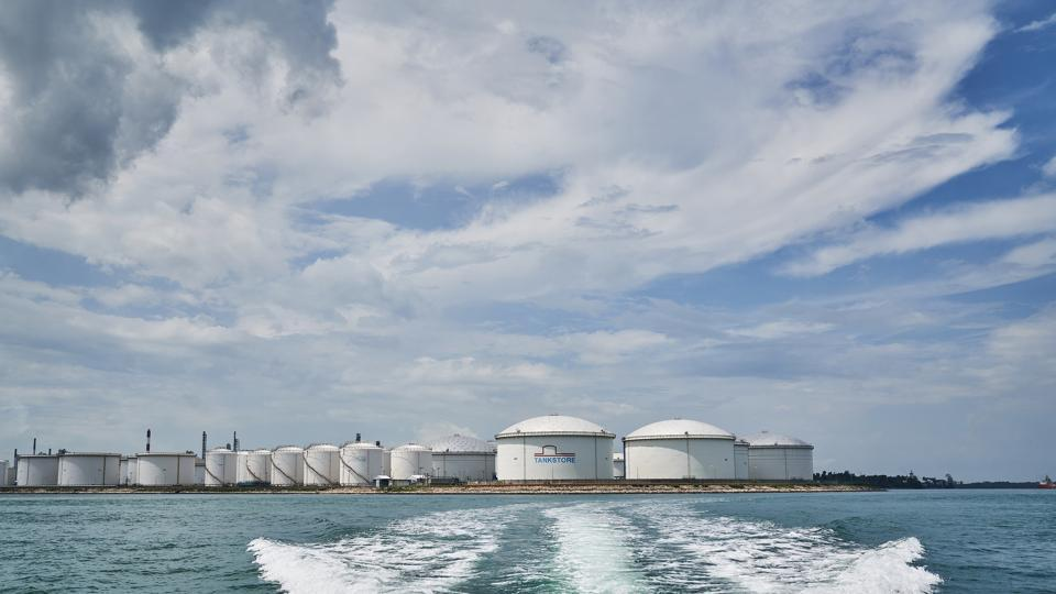 Oil Refineries and storage tanks standing at the Shell Eastern Petrochemicals Complex (SEPC) on Pulau Bukom are seen from a boat off the coast of Singapore.