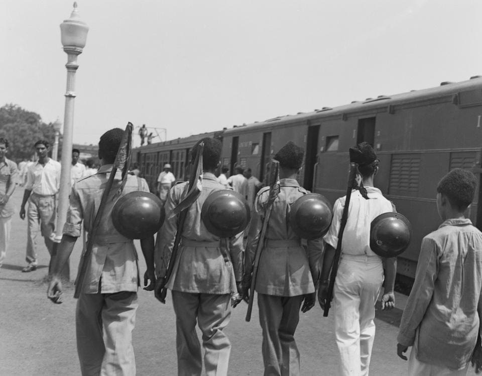 Muslim League National Guards on a platform at a railway station in New Delhi, India, August 1947. They were helping with the departure of six hundred Muslim residents of Delhi to Karachi, Pakistan, on a special train, following the partition of India.