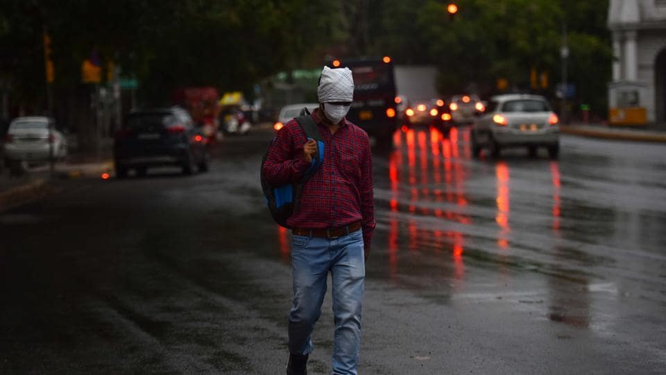 New Delhi, India - May 29, 2020: Commuters seen on road amid rainfall, in Connaught Place, New Delhi, India, on Friday, May 29, 2020. (Photo by Sanchit Khanna/ Hindustan Times)