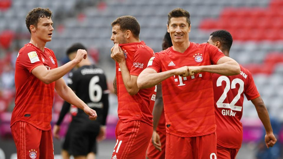 Bayern Munich's Robert Lewandowski celebrates with teammates their goal, as play resumes behind closed doors following the outbreak of the coronavirus disease (COVID-19)