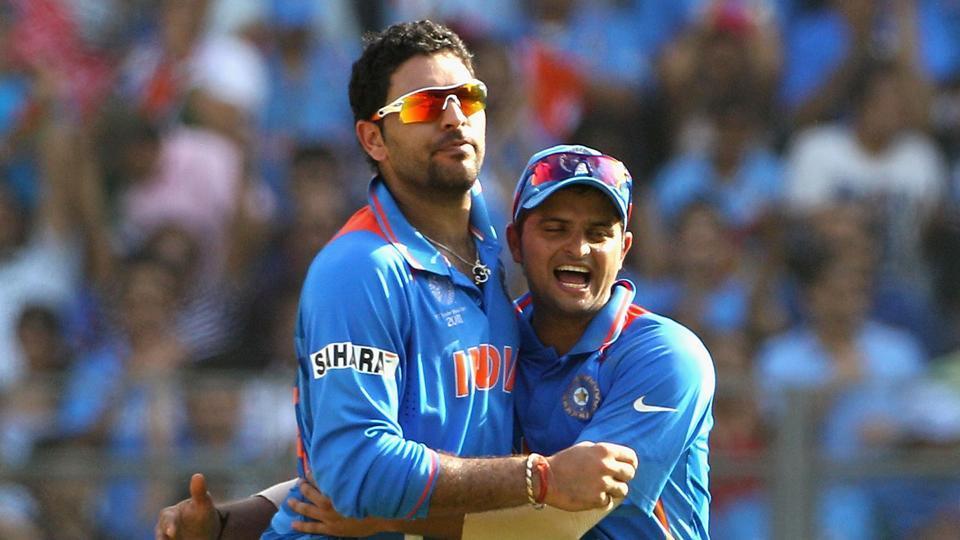 Yuvraj Singh (L) of India is congratulated by team mate Suresh Raina