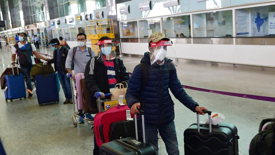 Indian nationals step out of the terminal at Kempegowda Airport after arriving by a special Air India flight from Frankfurt (Germany) amid COVID-19 pandemic, in Bengaluru.