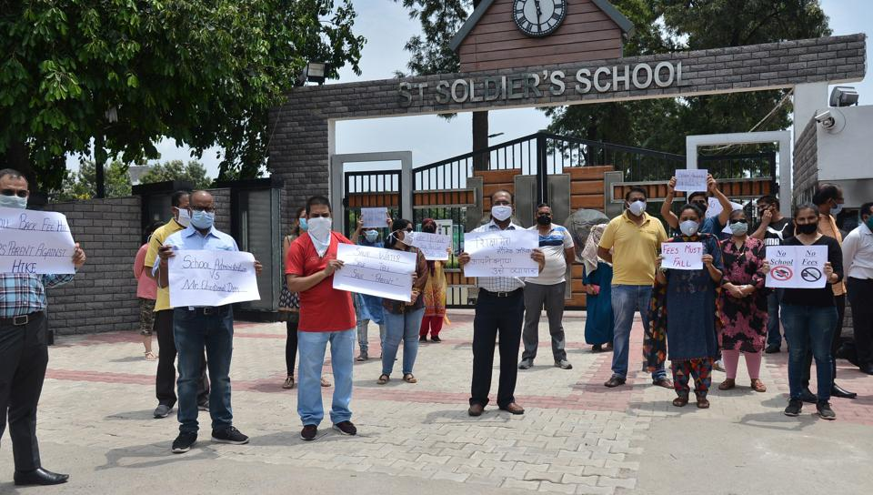 Parents protesting outside St Soldier Divine Public School in Sector 16, Panchkula, on Saturday.