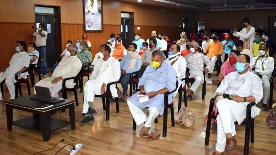 Bharatiya Janata Party (BJP) party leaders listening to Prime Minister Narendra Modi's Mann Ki Baat at the party's office in Patna on Sunday.