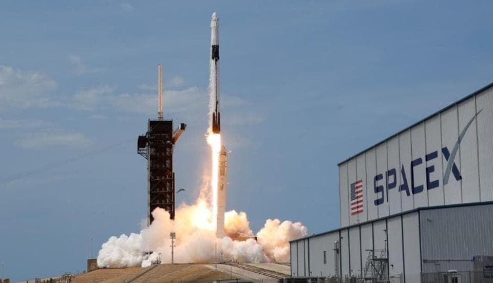 A SpaceX Falcon 9 rocket and Crew Dragon spacecraft carrying NASA astronauts Douglas Hurley and Robert Behnken lifts off during NASA's SpaceX Demo-2 mission to the International Space Station.