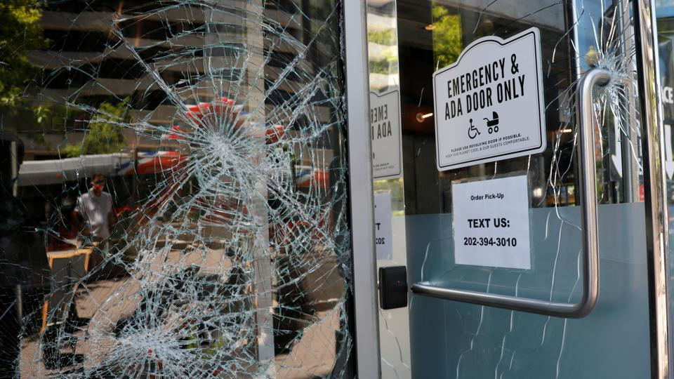 Damaged windows are seen at a restaurant near the White House which was vandalized during overnight protests and rioting amidst nationwide unrest following the death in Minneapolis police custody of George Floyd, in Washington, U.S., May 31, 2020.