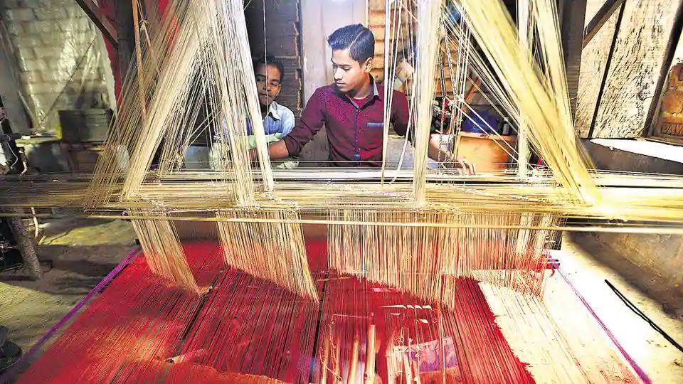 A weaver works on a handloom in Varanasi.